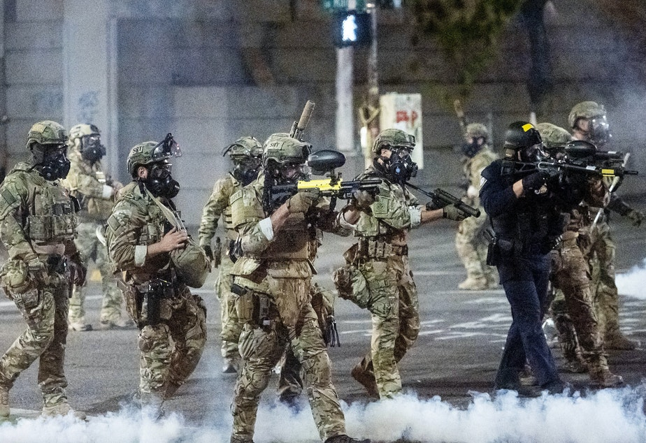 caption: Federal agents use crowd control munitions to disperse protesters at the Mark O. Hatfield U.S. Courthouse in Portland, Ore.