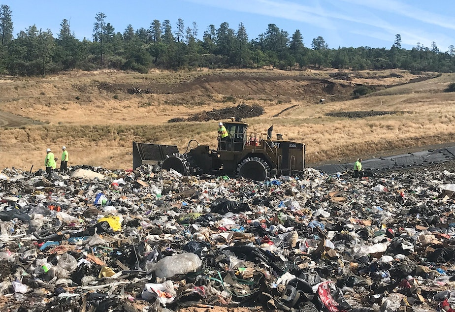 caption: Landfill workers bury all plastic except soda bottles and milk jugs at Rogue Disposal & Recycling in southern Oregon.