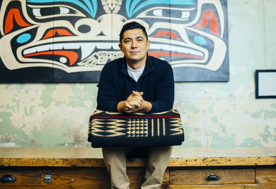 Artist and entrepreneur Louie Gong, inside his Pike Place Market shop
