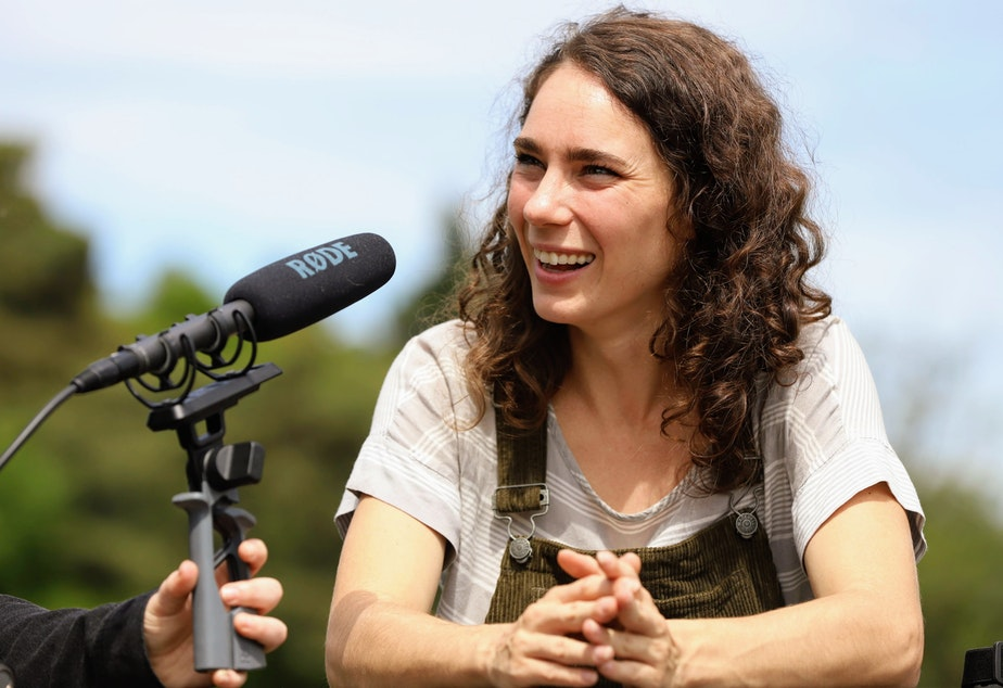 caption: Dr. Kaeli Swift, an avian researcher, speaking with KUOW's Seattle Now podcast in Seward Park.