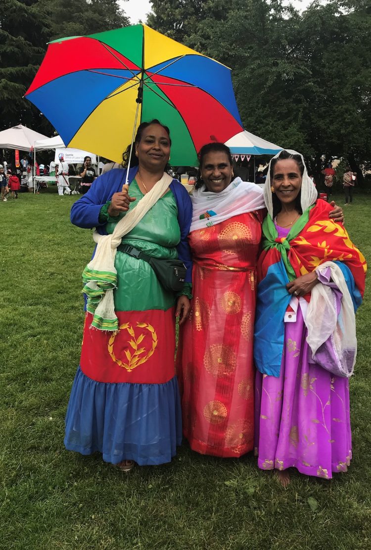 Akberet Asfaha (left) poses with friends at an event to celebrate Eritrea's Day of Independence.