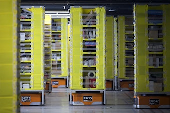 Robotic drive units transfer items at an Amazon fulfillment center on Friday, November 3, 2017, in Kent.