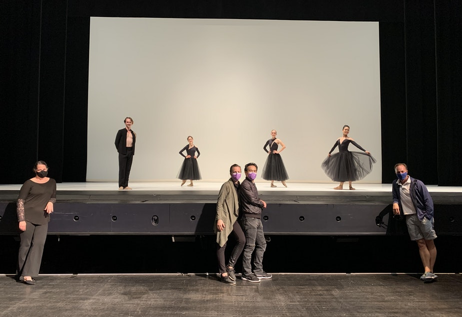 """caption: Choreographer Jessica Lang and her husband/collaborator Kanji Segawa, center front, with cast members from """"Ghost Variations."""" PNB Artistic Director Peter Boal is at front right, pianist Christina Seimens at left front."""