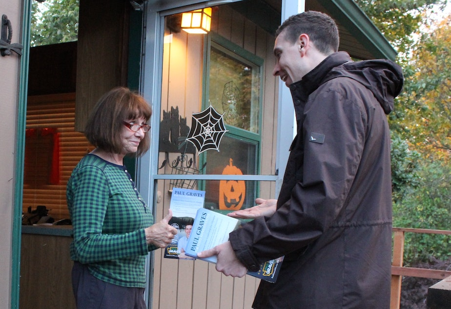 Paul Graves, Republican candidate in the 5th Legislative District, speaks with Jackie Treadwell on her porch in Maple Valley.
