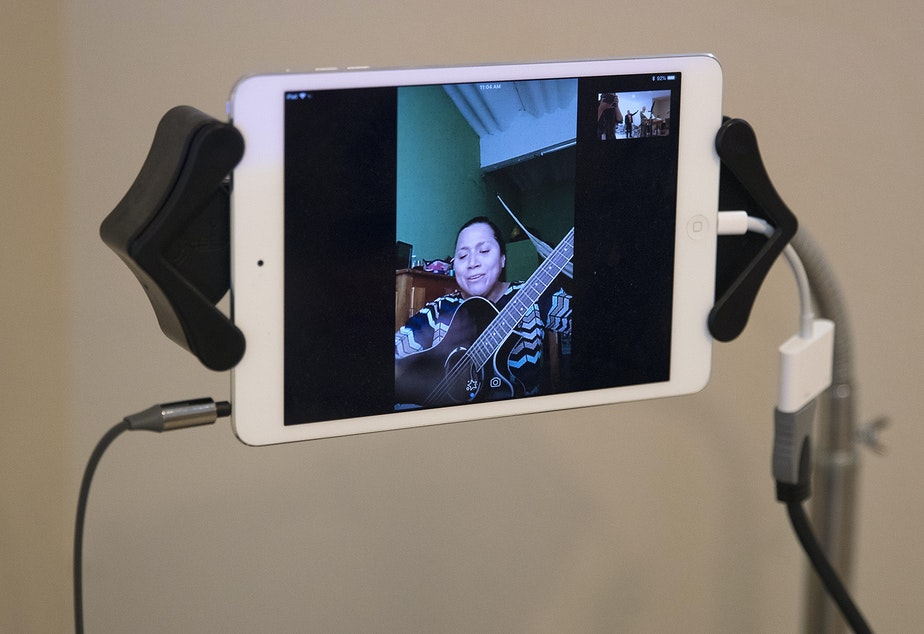: Reina Aquino Montejo sings through Skype during a church service in the basement of Nathan Robert's home, on Sunday, September 16, 2018, in Des Moines.