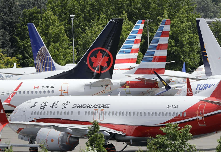 caption: Grounded Boeing 737 Max airplanes crowd a parking area in Seattle in June, 2019.