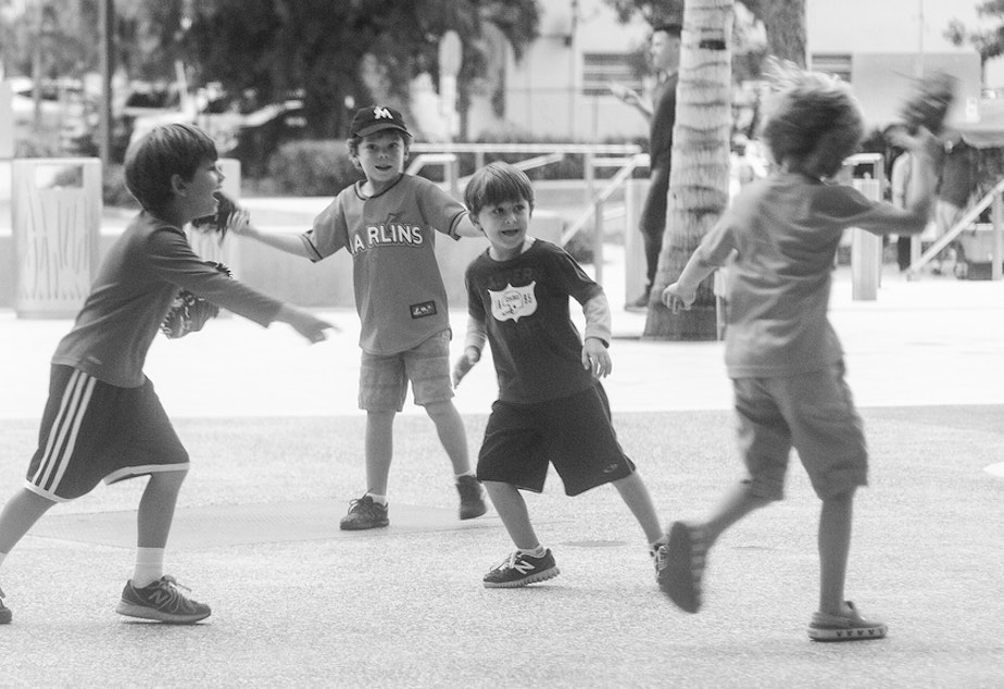 caption: File photo of kids playing tag.