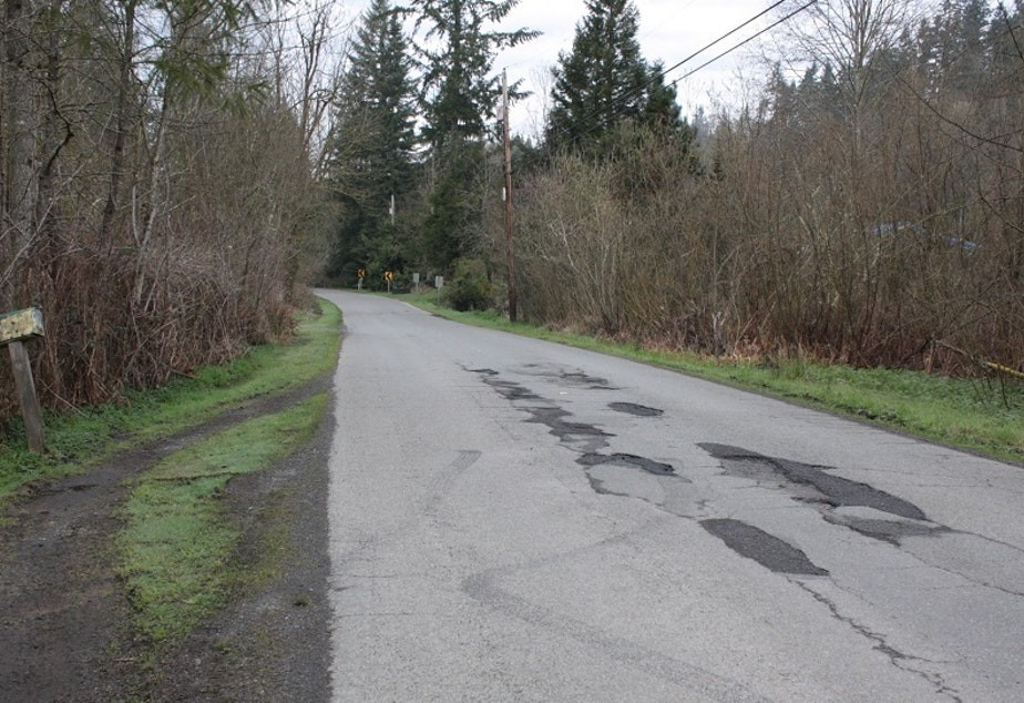 This county road between Maple Valley and Issaquah may not look like a major traffic corridor. But come rush hour, it's bumper to bumper on county roads like this as commuters seek out alternate routes to shave precious minutes off grueling commutes.