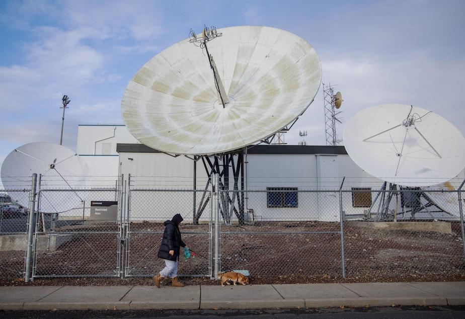 caption: Michelle Aguilar Ramirez walks her dog Bruce in her Spokane, Washington, neighborhood.