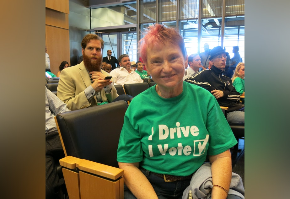 Uber provided drivers like Suzy Harrison with shirts that say, 'I Drive, I Vote.'