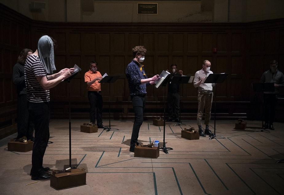 caption: Members of the Compline Choir rehearse while wearing masks ahead of a live-streamed Easter service on Sunday, April 12, 2020, at St. Mark's Episcopal Cathedral on 10th Avenue East in Seattle.