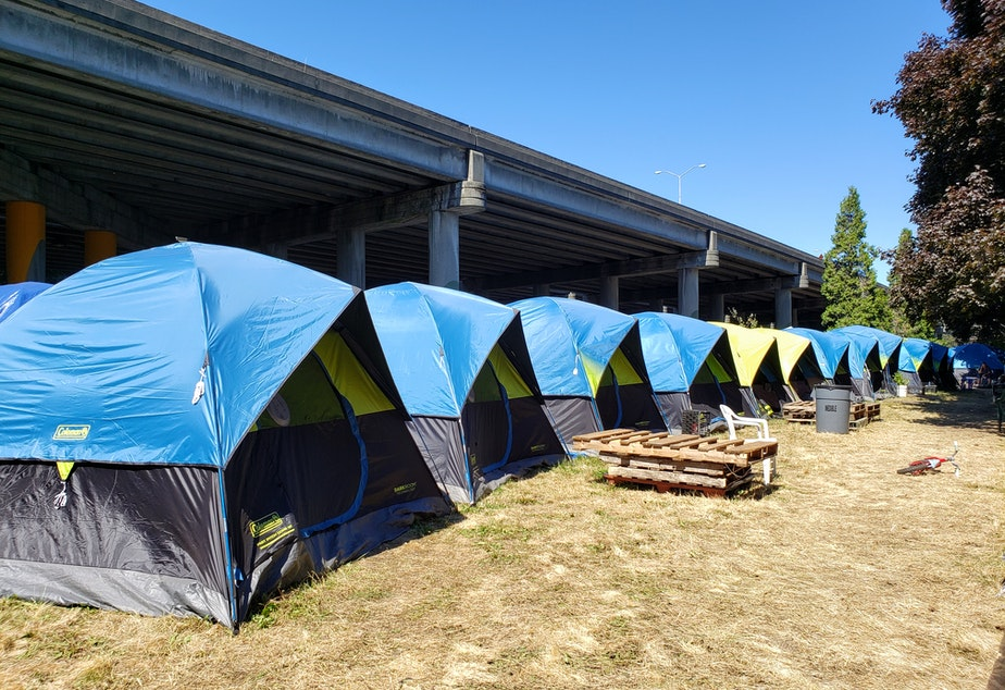 caption: Tent City 3 near I-5 in Ravenna on Tuesday, August 27th, 2019.