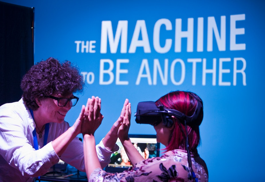 """Sandy Cioffi in training with """"The Machine To Be Another,"""" part of the Creative Exchange Lab pilot at Pacific Science Center in July 2018."""