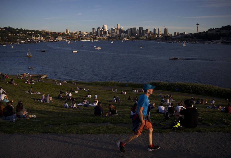 caption: People gather on Wednesday, May 27, 2020, at Gas Works Park in Seattle.