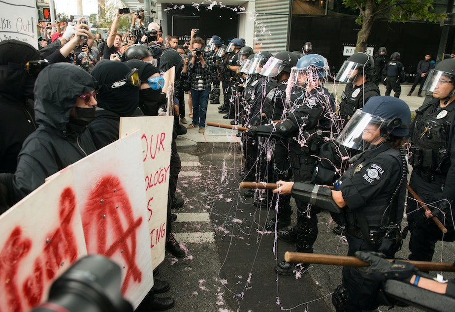 Protesters sprayed Seattle Police with silly string moments before attempting to break the line. Click or tap on the image for slideshow.