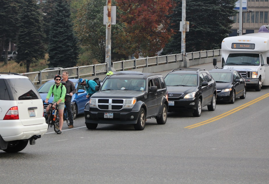 Cyclists at Pine and Boren await their turn.