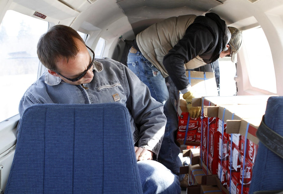 caption: Our cargo plane flight from Kotzebue to Kivalina. It was about the size of a minivan and was packed with, of all things, Coca Cola. Except for what residents hunt or gather, most of the food flown is in processed.