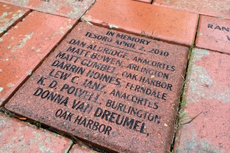 Workers killed in a 2010 explosion at a Tesoro refinery in Anacortes are commemorated outside Everett City Hall.