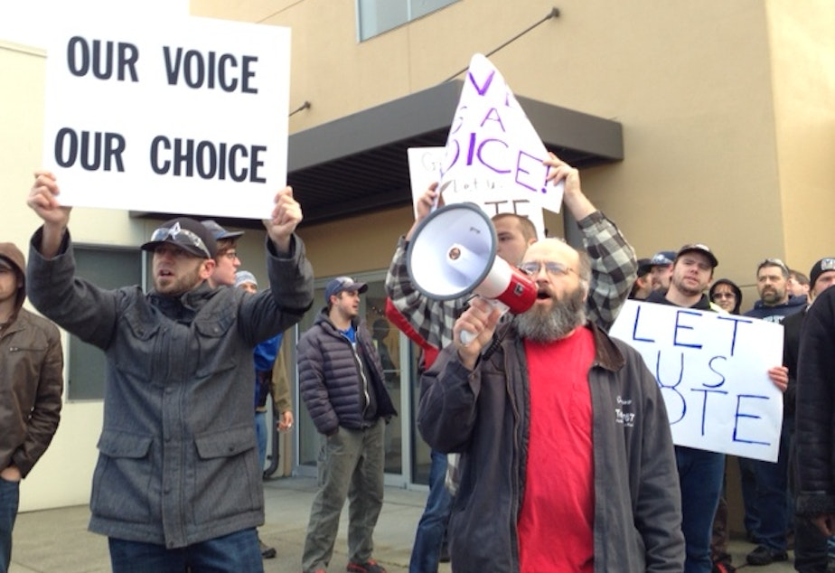 caption: Union members marched yesterday in support of taking a vote on the latest Boeing contract offer. Weakened unions have chipped away at the middle class in King County.