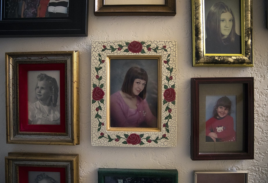 caption: A photograph of Piper Travis, center, hangs on a wall of photographs on Tuesday, January 22, 2019, at Greg and Paulette Beck's home on Whidbey Island.