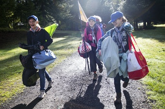 From left, Zephyra Bingham, 14, Ariana Spradlin, 13, and Rachel Becking, 13, carry their belongings before setting up their tents during the Boy Scouts of America Bootcamp on Saturday, October 6, 2018, at Camp Thunderbird in Olympia. Tap or click on the first image to see more.
