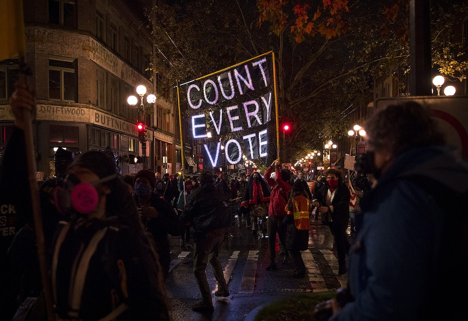 caption: Hundreds gathered to march through Pioneer Square on Wednesday, November 4, 2020, the day after the 2020 presidential election, in Seattle. The event focused on making sure every vote was counted and every person was protected. A coalition of groups who have been demonstrating for racial justice and against police brutality in Seattle every day for months asked participants to show up for Black lives every day, not only during the election.