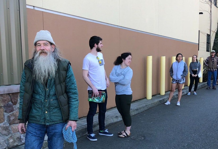 caption: Social distancing at Trader Joes on Saturday, March 21, 2020: Peter Ashenfelter, Katie and Connor Findlay, Cindy Aguirre, Nicole Defuria, and Curtis Wolff.