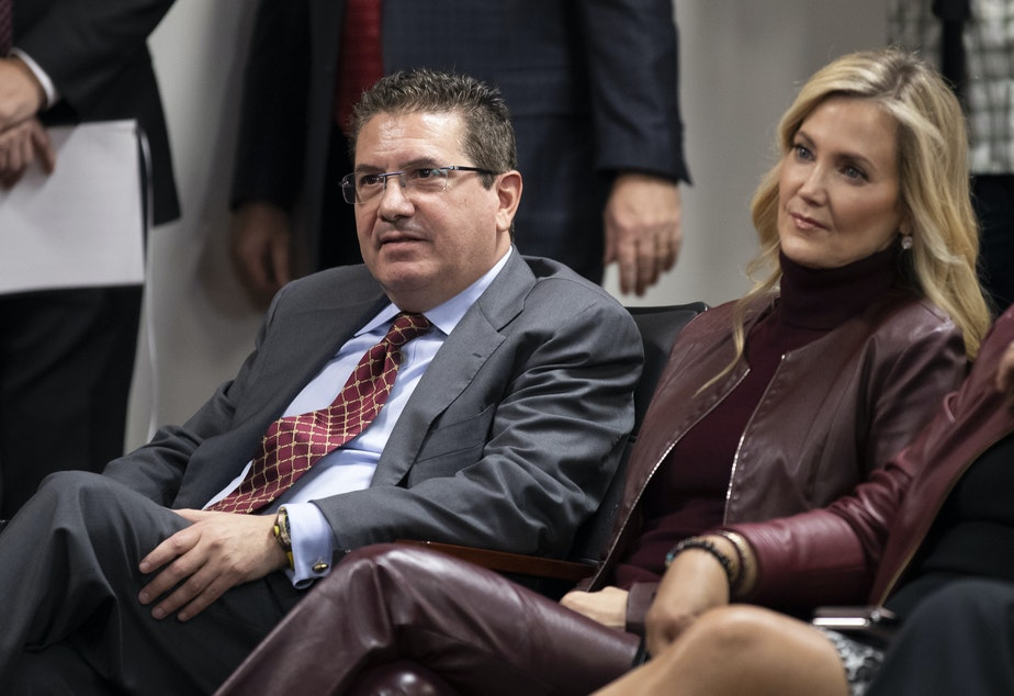 caption: The owner of the NFL's Washington team, Dan Snyder, seen with his wife, Tanya Snyder, last year. The team has been fined $10 million by the league for adverse workplace conditions.