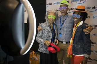Joseph Jones, an Amazon employee on the marketing team for Amazon channels, takes pictures with his mother, Cathy Jones, right, and his grandmother, Hattie Perry, left, during Amazon's bring your parents to work day on Friday, September 15, 2017.