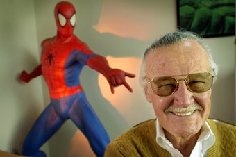 """Stan Lee, 79, creator of comic-book franchises such as """"Spider-Man,"""" """"The Incredible Hulk"""" and """"X-Men,"""" smiles during a photo session April 16, 2002, in his office in Santa Monica, Calif. (AP Photo/Reed Saxon)"""