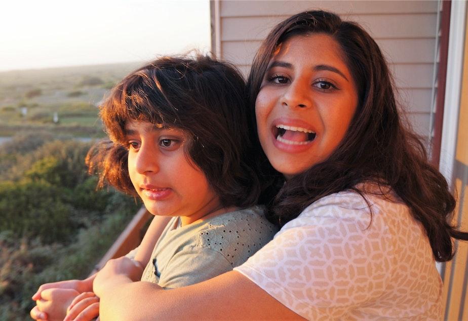 caption: Saba Ali (left) with her older sister Huma.