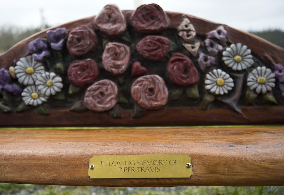 caption: A bench honoring Piper Travis is shown outside of the Good Cheer Food Bank on Tuesday, January 22, 2019, on Grimm Road in Langley.