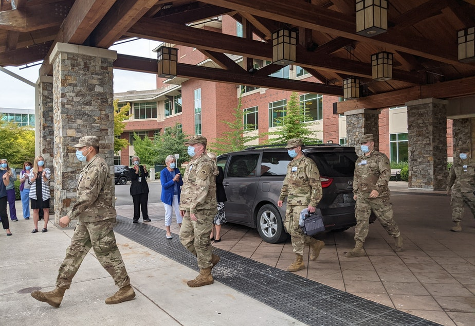 caption: National Guard deploys at Peacehealth Sacred Heart Medical Center at Riverbend in Springfield on August 30.