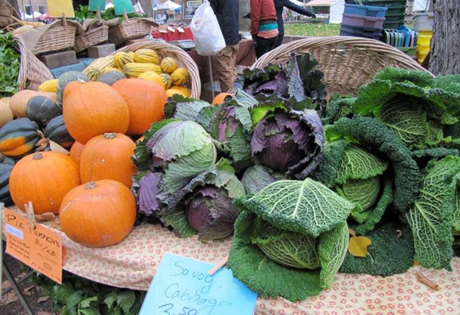 <p>An array of fresh vegetables is displayed on a table at a farmer's market.&nbsp;</p>