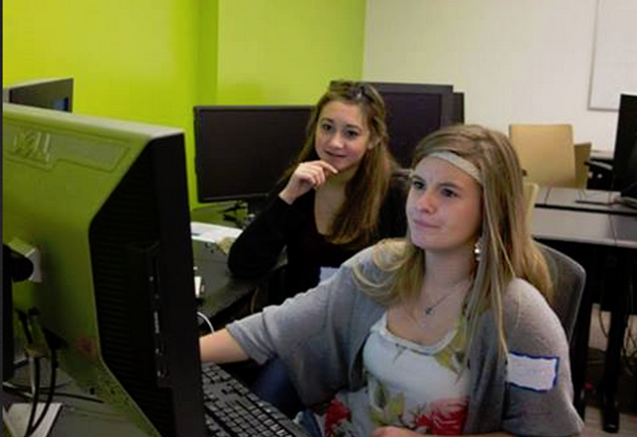 Elizabeth Brace, right, works on coding at a University of Washington camp.