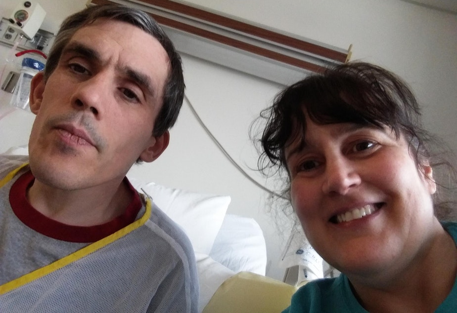 caption: Christopher Davis poses for a selfie with his sister Deborah Davis. Christopher is one of hundreds of people who are stuck in Washington hospitals because of a lack of community placements.