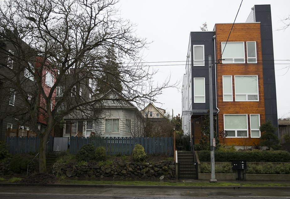 caption: Homes near the intersection of 23rd Avenue East and East Thomas Street in Seattle.
