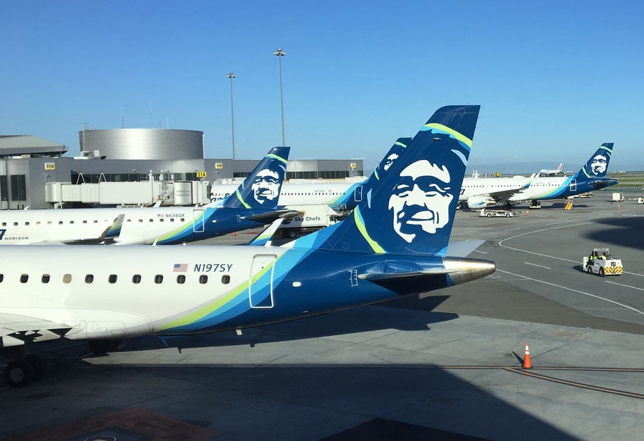 caption: Alaska Air jets at San Francisco International Airport
