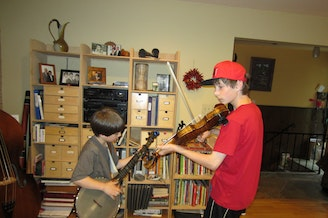 Eli and Oliver Abrahamson at home in 2012. The Abrahamson boys and their family got their start busking at the Northwest Folklife Festival as the Smalltime String Band.
