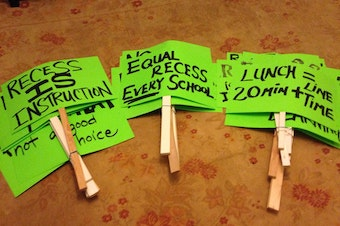 Signs promote lunch and recess for Seattle students.