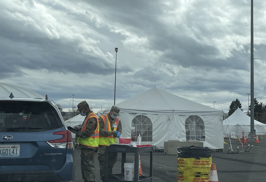 caption: Staff with the U.S. National Guard vaccinate people against Covid-19 in Yakima, WA on Easter Sunday 2021. The FEMA site is designed to vaccinate 1,200 people a day, with the potential to serve 3,000.