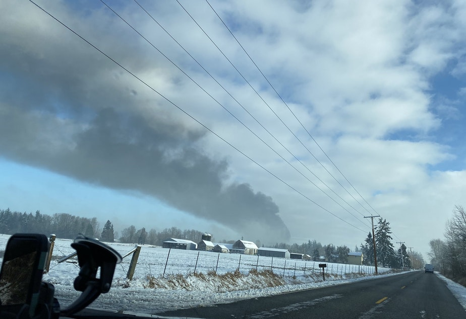 caption: Smoke from an oil train that derailed Dec. 22 in Custer could be seen from miles away.
