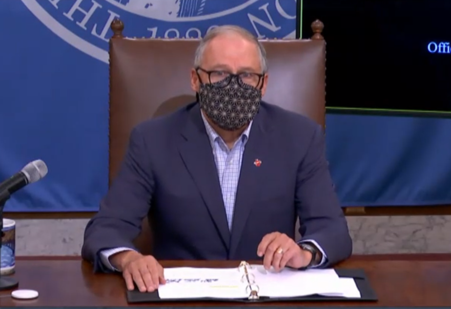caption: Washington state Governor Jay Inslee presents new school reopening guidelines at a press conference on December 16, 2020.