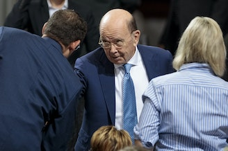 Commerce Secretary Wilbur Ross attends a July speech by President Trump in Granite City, Ill. The Supreme Court has temporarily shielded Ross from having to sit for questioning under oath for the 2020 census citizenship question lawsuits.