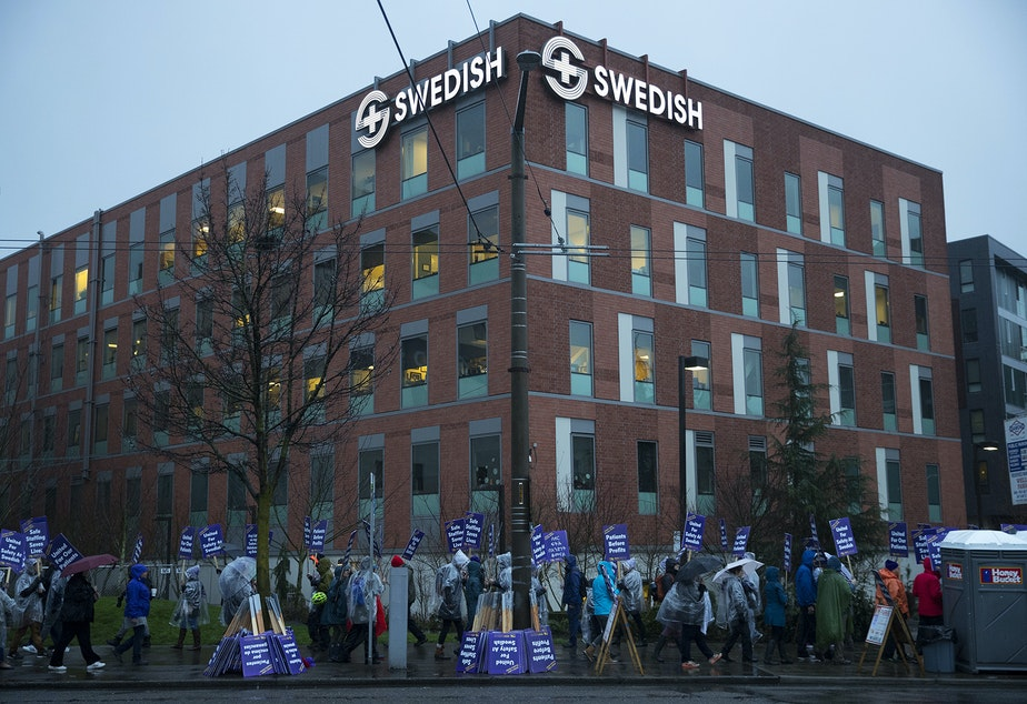 caption: Nurses and caregivers strike on Tuesday, January 28, 2019, outside of the Swedish Ballard Campus along NW Market Street in Seattle.