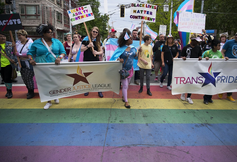 The Trans Pride Seattle march crosses Broadway Street on Friday, June 22, 2018, near Cal Anderson Park in Capitol Hill.