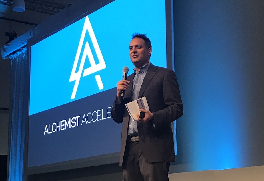 caption: Ravi Belani, managing director at Alchemist Accelerator, speaks at a recent presentation by the startup in Sunnyvale, Calif.