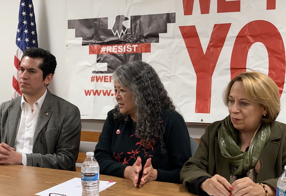 caption: From left, Mexican Sen. Israel Zamora, United Farm Workers President Teresa Romero and Sen. Bertha Alicia Caraveo hold a press conference Monday, Jan. 27, after meeting with dairy workers. They shared stories of poor working conditions on farms.