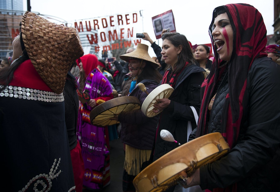 Raven Healing sings with Missing and Murdered Indigenous Women of Washington group members during the Women's March on Saturday, January 20, 2018, on Pine St., in Seattle. Tap or click on the first image to see more.
