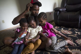 Osman Mohamed, of Somalia, and his three daughters, ages 2, 4 and 5. Osman hoped to find paradise in Seattle, but in his first year, his family witnessed a shooting and he was hit by a car.